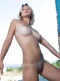 Hot naked girl outdoors