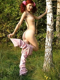 Red-haired women female pics in a forest